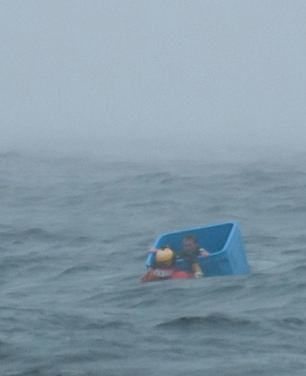 Ocean survivor floats in crate-Joel Brady-Power