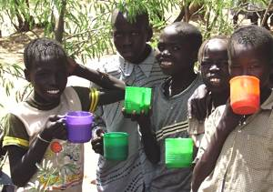 African kids with water cups