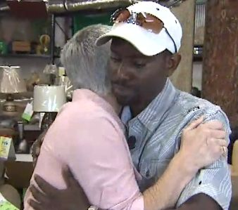 Embrace woman buys furniture for stranger