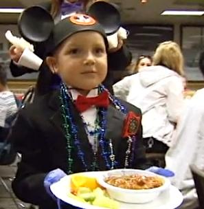 boy serving food Disney wish-KSLvideo