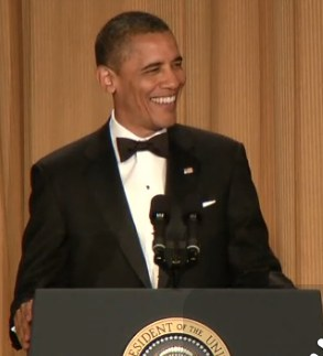Obama laughs podium