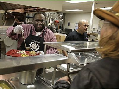 Feeding in soup kitchen-Terry Brown UPS employee award winner