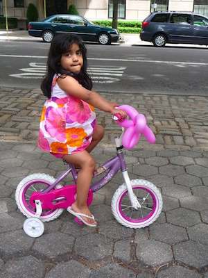 biking little girl in NYC