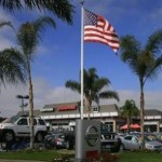 Nissan lot with flag palm trees