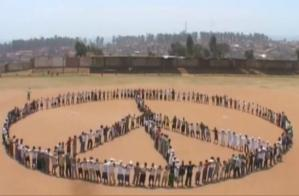 Peace sign formed by human bodies