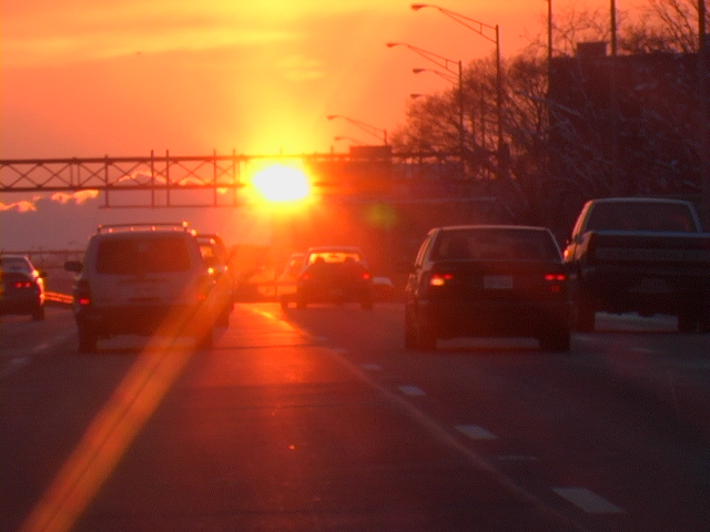cars driving at sunset (c) geri weis-corbley