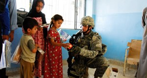 soldier gives gifts
