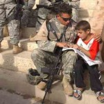 soldier_helps_iraqi_boy