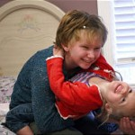 Photo by Michael Brandy, Deseret Morning News - Emily, 15 plays with younger sister