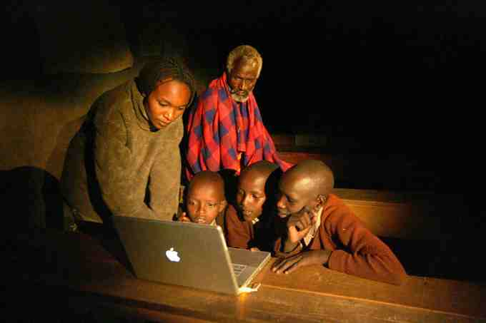 Masai students work at night, after herding during the day
