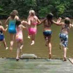 girls-jumping-lake.jpg
