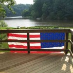 flag on our deck railing