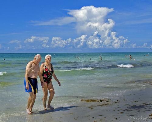Beach walking elderly couple-Don Johnson 395-cc-Flickr
