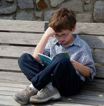 reading outside boy-wsh1266-flickr-cc