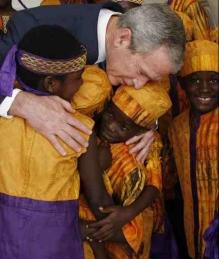 bush-embraces-african-choir.jpg