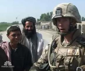 US soldier talks to Afghan villagers
