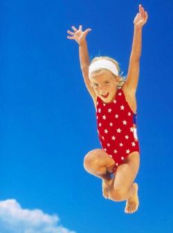girl jumps for joy - Photo by Sun Star