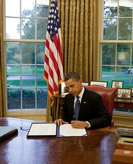 obama-signs-at-desk.jpg