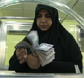 iraqi-female-w-cash-bank.jpg