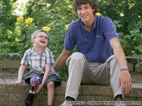jordan-thomas-w-prosthetic-boy.jpg
