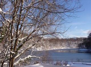 snowy-lake-blue-skies.jpg