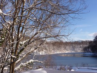 snowy-lake-blue-skies.jpg