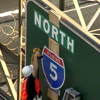 freeway-guerilla-sign-catherine-cummings.jpg