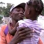 haiti-dad-kid-reunited.jpg