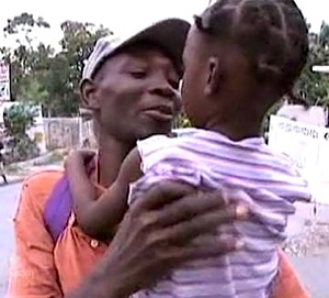 haiti-dad-kid-reunited.jpg