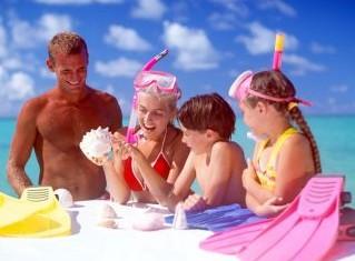 family-at-beach-flippers-sun