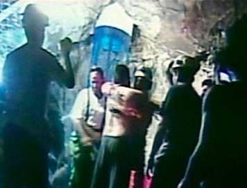 Rescuer reaches trapped Chilean miners