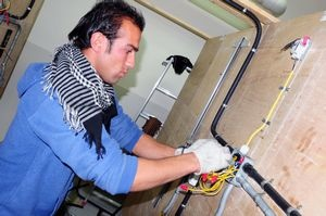 Afghan learns electrical trade, US military photo
