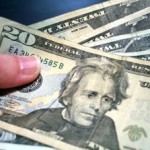 dollars-hand-giving-cohdra-morguefile