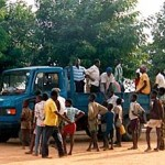 villagers waiting with a truckload, USAID photo