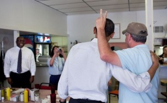"""Sometimes the unexpected happens. At a cafe in Missouri, I was trying to capture patrons snapping photos of each other with the President when this guy did what wise-guys do."" (Official White House Photo by Pete Souza)"