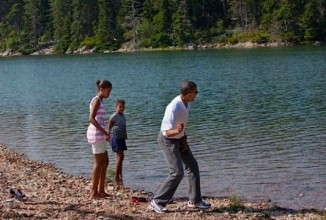 """On a weekend trip to Acadia National Park in Maine, the President showed his daughters, Malia and Sasha, how to skip stones during a hike in the park."" (Official White House Photo by Pete Souza)"