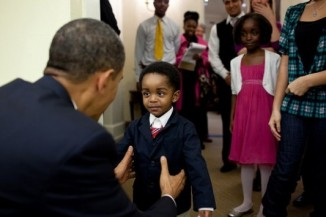 President Obama greets his mini-me, a young visitor to the Oval Office, Feb. 5, 2010. (Official White House Photo by Pete Souza)
