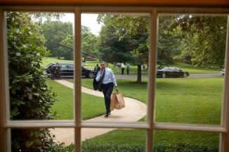 President Barack Obama returns to the Oval Office after going on a hamburger run for West Wing staffers and aides, May 29, 2009. (Official White House Photo by Chuck Kennedy)