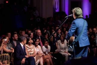 """Paul McCartney sings ""Michelle"" to First Lady Michelle Obama during an event honoring McCartney as winner of the annual Gershwin Prize. I knew this was a special moment but didn't have a full realization of its significance until when I later heard the President telling others that his wife could never have imagined as an African-American girl growing up on the South side of Chicago that someday a Beatle would be singing this song to her."" (Official White House Photo by Pete Souza)"
