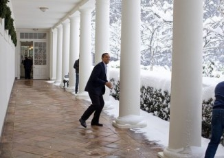 """Snowball in hand, the President chases Chief of Staff Rahm Emanuel on the White House colonnade. To escape, Rahm ran through the Rose Garden, which unfortunately for him, was knee-deep in snow."" (Official White House photo by Pete Souza)"