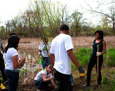 Michelle Obama plants trees with youth in MD, WH photo