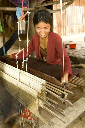 Cambodian crafts people produce silk items once again
