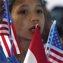 Indonesian child holds US flags -USAID photo