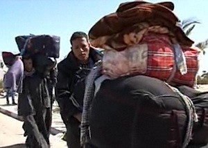 Refugees stream into Tunisia (NBC video)