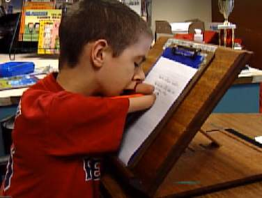 boy with no hands aces penmanship (WCSH video)