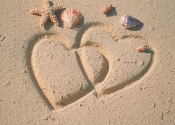 hearts in sand sun - Photo by Sun Star