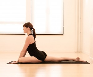 Pigeon yoga pose via Gaiam.com