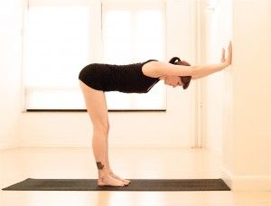 Wall Plank yoga pose via Gaiam.com