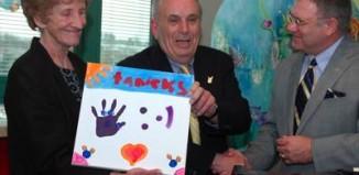 WV hospital donation, Mike Ross, center