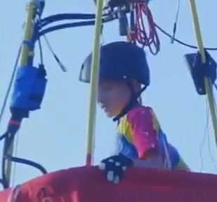 KOB-TV screenshot of historic boy balloon pilot